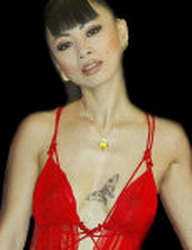 Different pictures of the chinese actress <b>Bai Ling</b>, that (don't be fooled by the tiny thumbnails) seems to like showing her nipples to everyone, especially on a red carpet when wearing a stunning and revealing red dress.